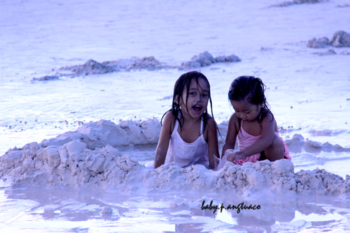 My cute friends playing in the sand