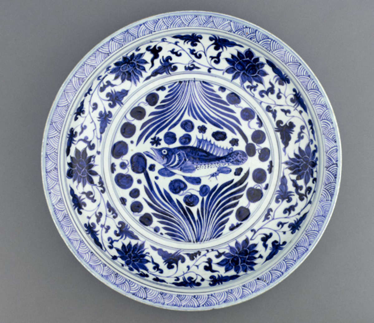 A Yuan dynasty blue-and-white porcelain dish with fish and flowing water design