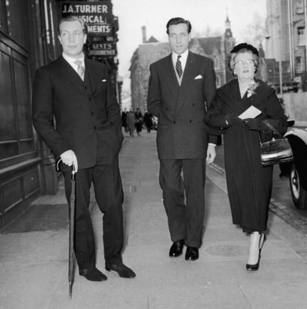 From left to right, John Aspinall, John Burke, and Aspinall's mother, Lady Osborne, arrive for a court hearing, all charged with gaming offences, 15th February 1958. (They were acquitted)
