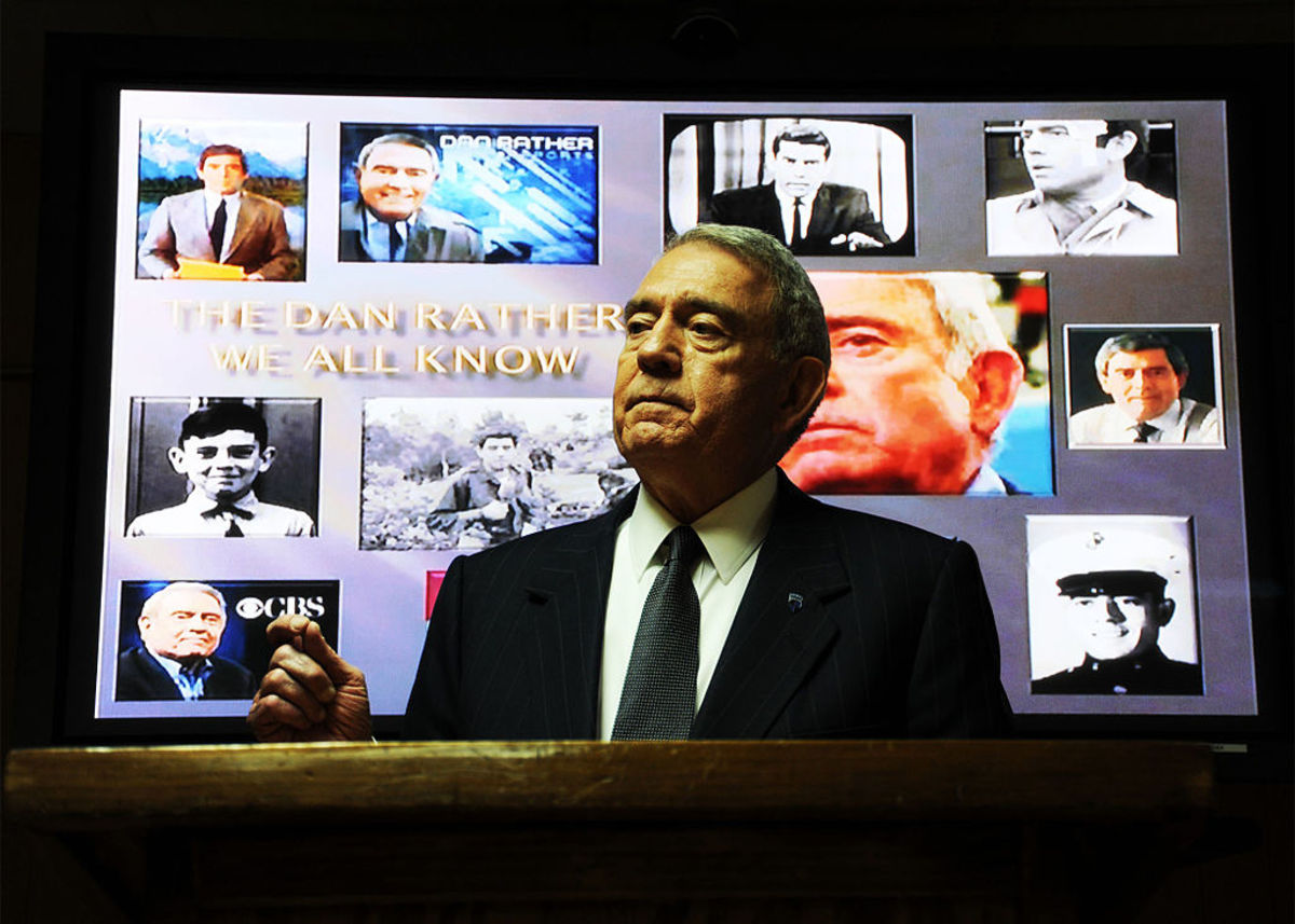 Dan Rather, anchor and editor of Dan Rather Reports on the cable network HDNet, speaks before a group of North Atlantic Treaty Organization Training Mission Afghanistan commanders in the Leadership Conference Room on Camp Eggers, Kabul, Afghanistan,