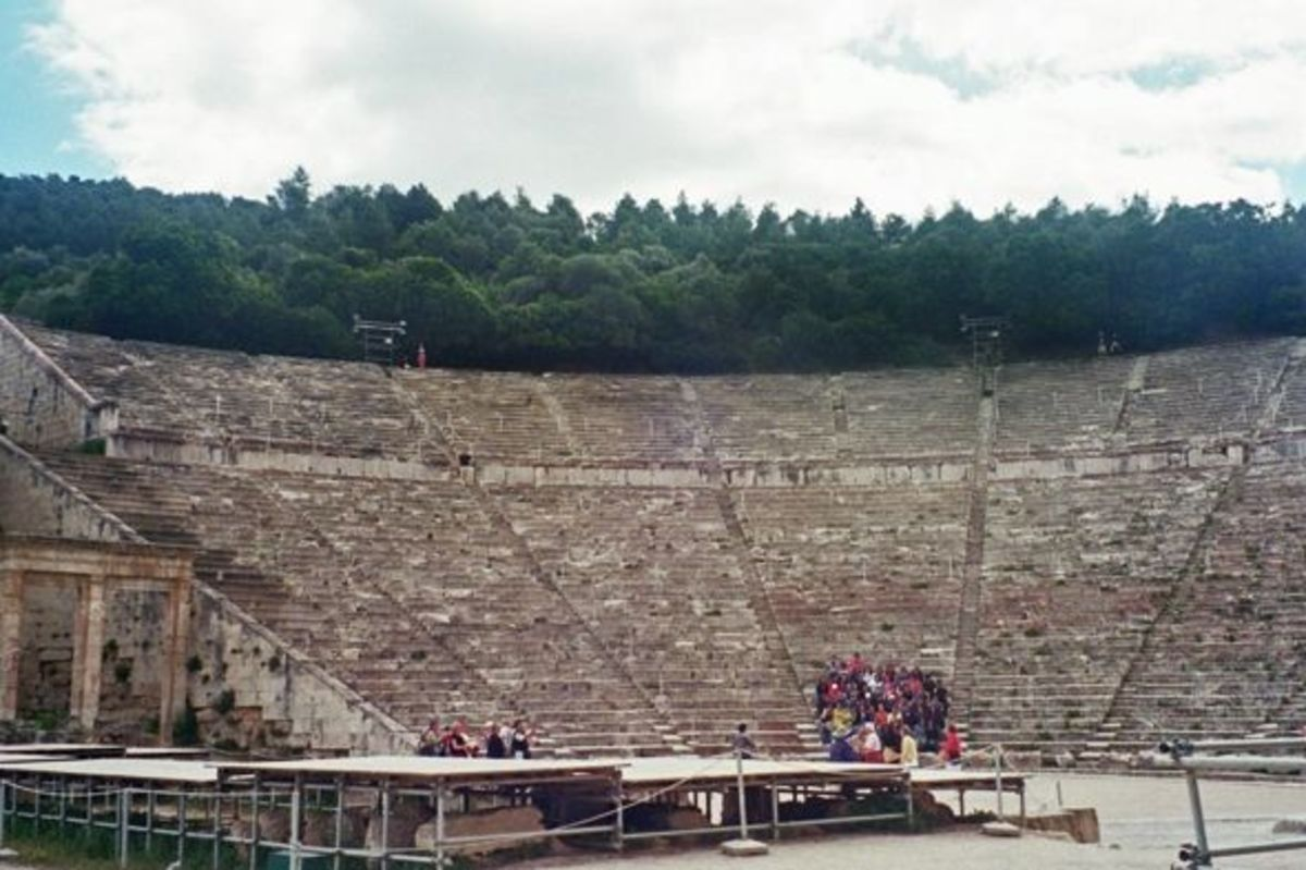 Lefthand (northwest) side of cavea. In the foreground is the modern-day stage built to protect the ancient one. Since 1954, the Epidaurus Festival has staged ancient Greek tragedies and comedies as well as more modern productions (as well as some Sha