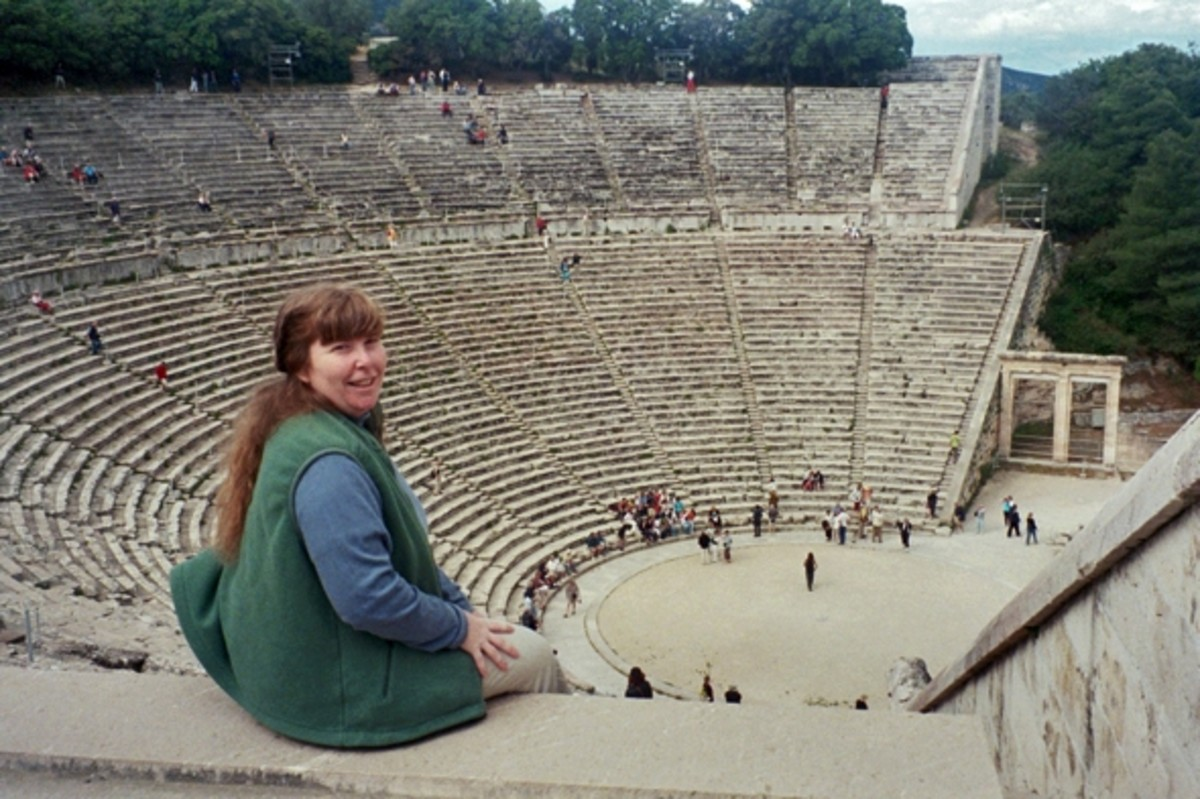 Your narrator enjoying the view from the upper seats of Epidaurus Theater. What a lovely place! Notice the side gates built like the Propylaia of Athens.