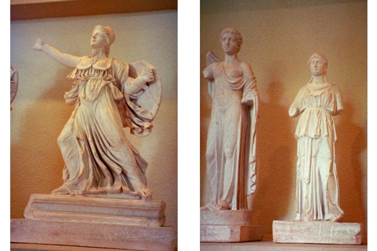 "Votives in the Epidaurus Museum, probably gifts of thankful patients to patron goddesses. At right, Athena. In the middle, the goddess Hygeia, ""Health,"" with a snake around her neck. At left is an ""Aphrodite in Arms."" If you're a student trying to le"