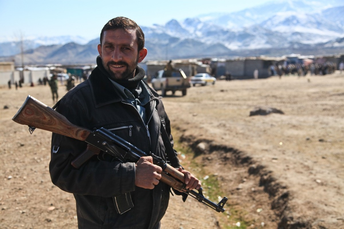 A Taliban Fighter With His Weapon