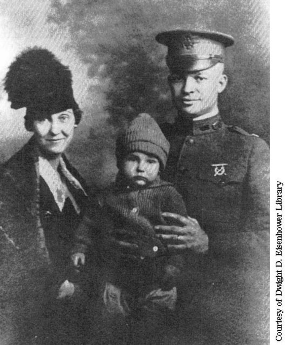 """Doud """"Ikey"""" with his parents, Mamie and Dwight."""