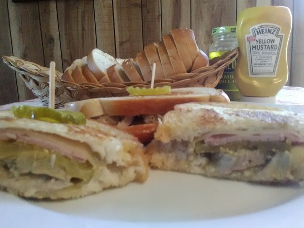 Grilling melts the cheese into the meats and pickles.