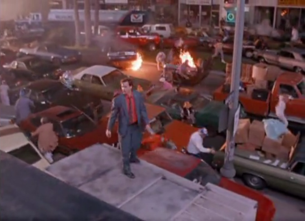 Harry Warshello (Anthony Edwards) looks around at the chaos he's created