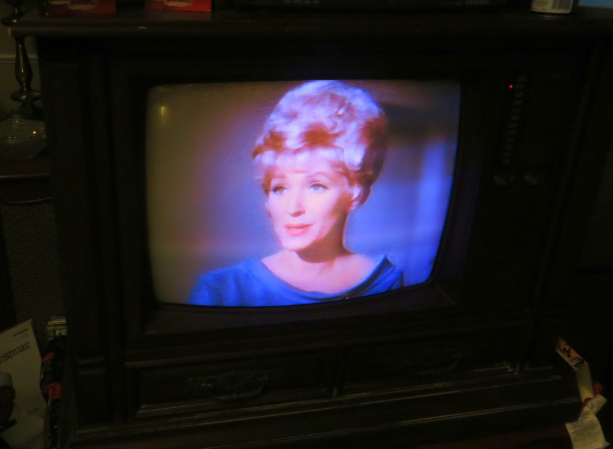 Majel Barrett as Nurse Christine Chapel, Star Trek (TV Series) Amok Time, playing on the 1980 Curtis Mathes Model G550, Color Television Console, Early American Design, Chassis C81-7 Medium Pecan.