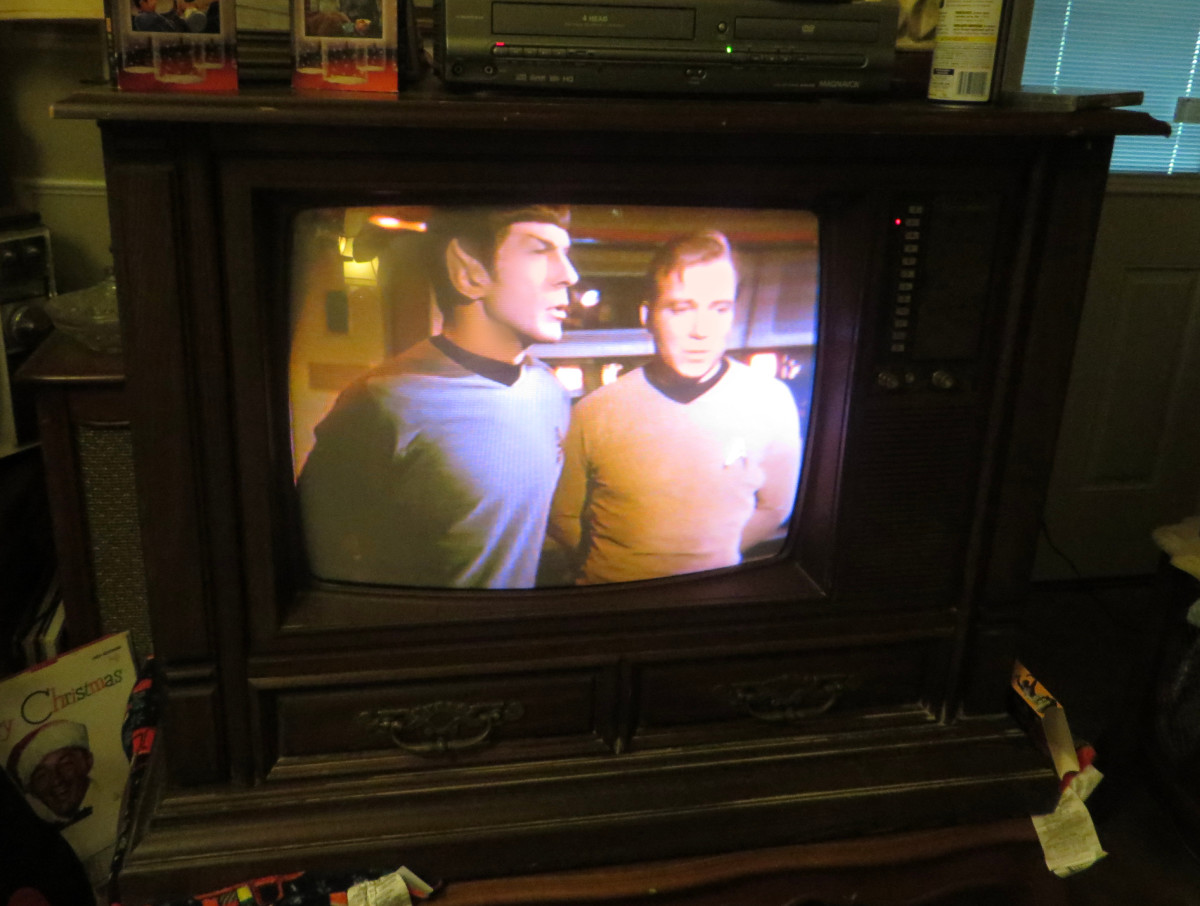 Leonard Nimoy as Mr. Spock, and William Shatner as Captain Kirk on the 1980 Curtis Mathes Model G550, Star Trek, Amok Time. Color Television Console, Early American Design, Chassis C81-7 Medium Pecan.