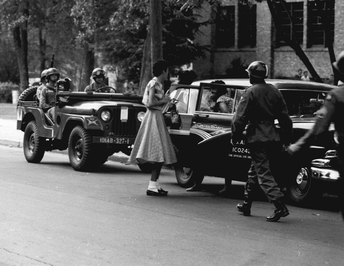 Soldiers from the 101st Airborne Division escort African-American students to Central High School in Little Rock in September 1957.