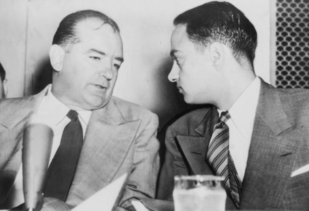 Senator Joseph McCarthy (left) chats with his attorney Roy Cohn during the Senate McCarthy-Army Subcommittee hearings.