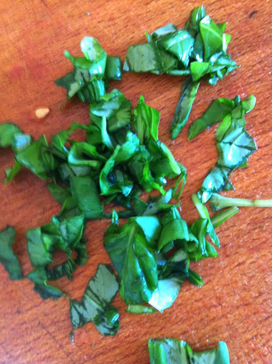 Chop basil leaves