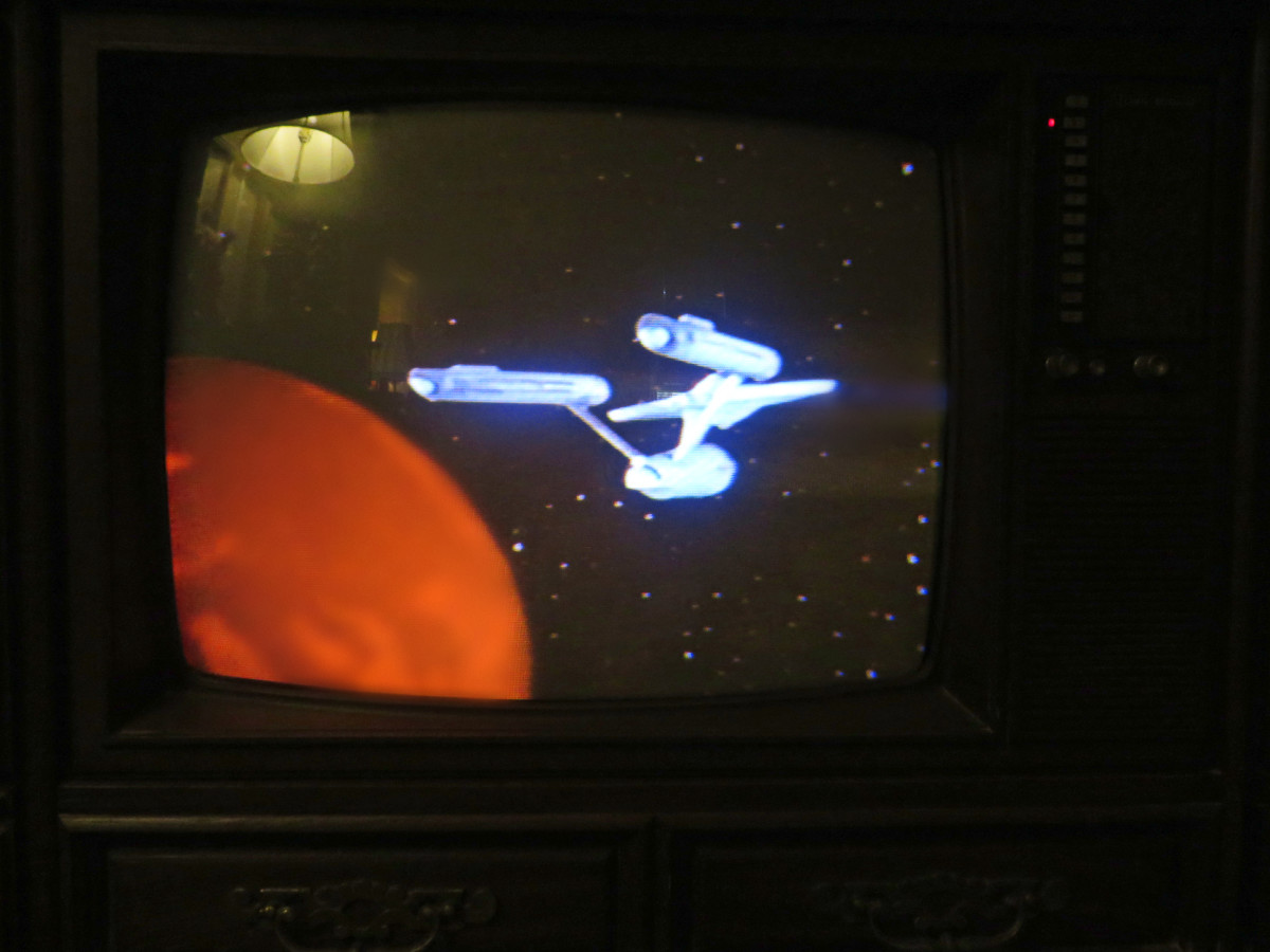 The Star Ship Enterprise, Star Trek VHS Tape on the 1980 Curtis Mathes TV Model G550. Color Television Console, Early American Design, Chassis C81-7 Medium Pecan. Both the tape and the television had been in a storage shed for countless years.