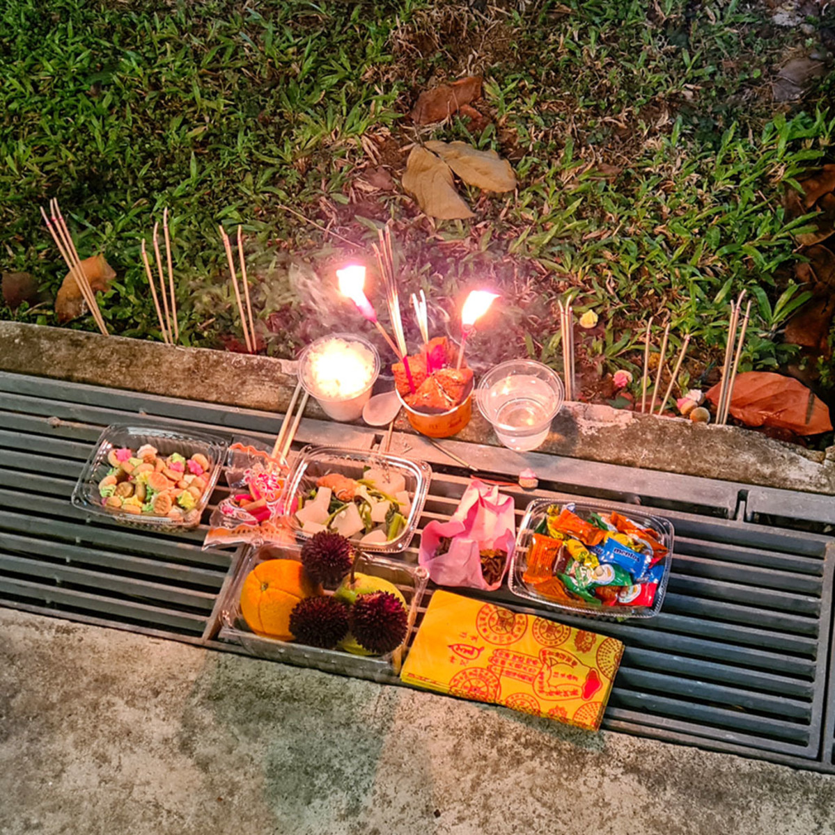 Chinese Ghost Festival prayer items left at the roadside.