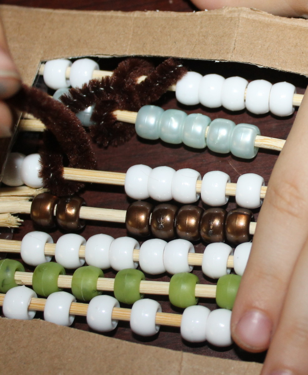Children creating a Chinese abacus