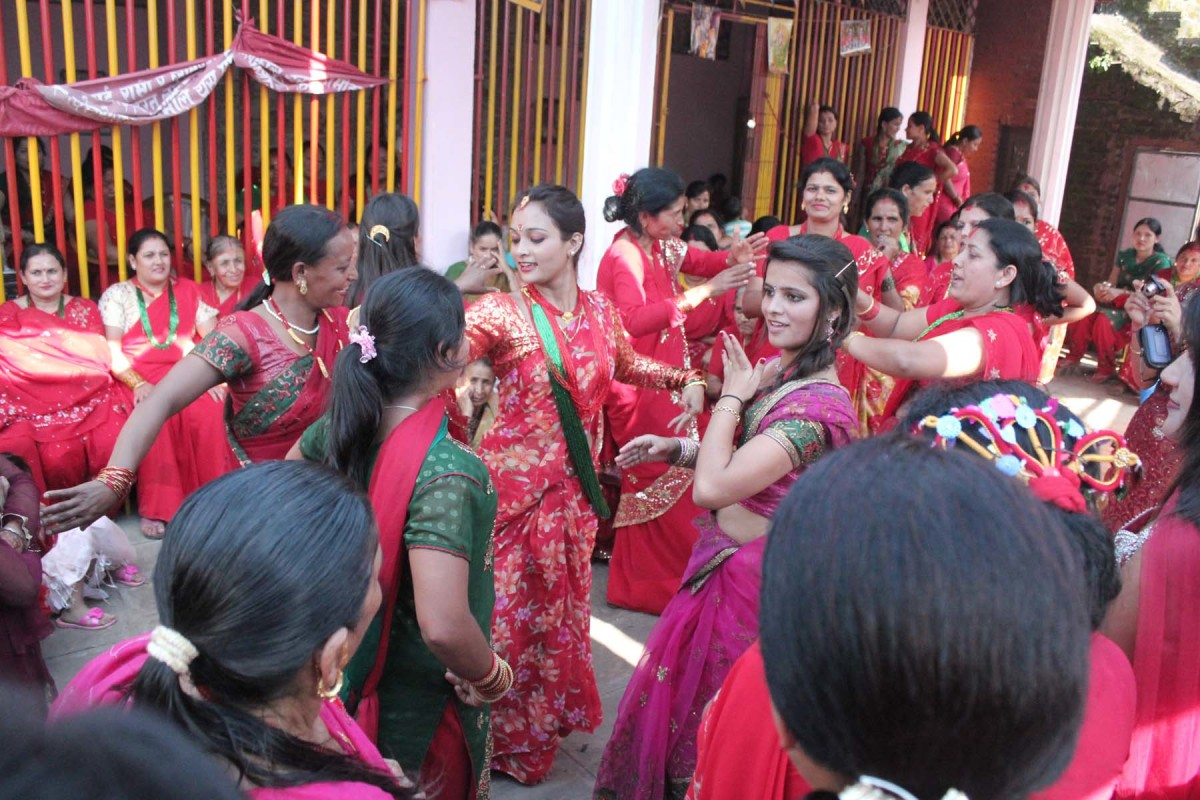 Ladies dancing in a temple in Lalitpur, Nepal on the occasion of Teej.