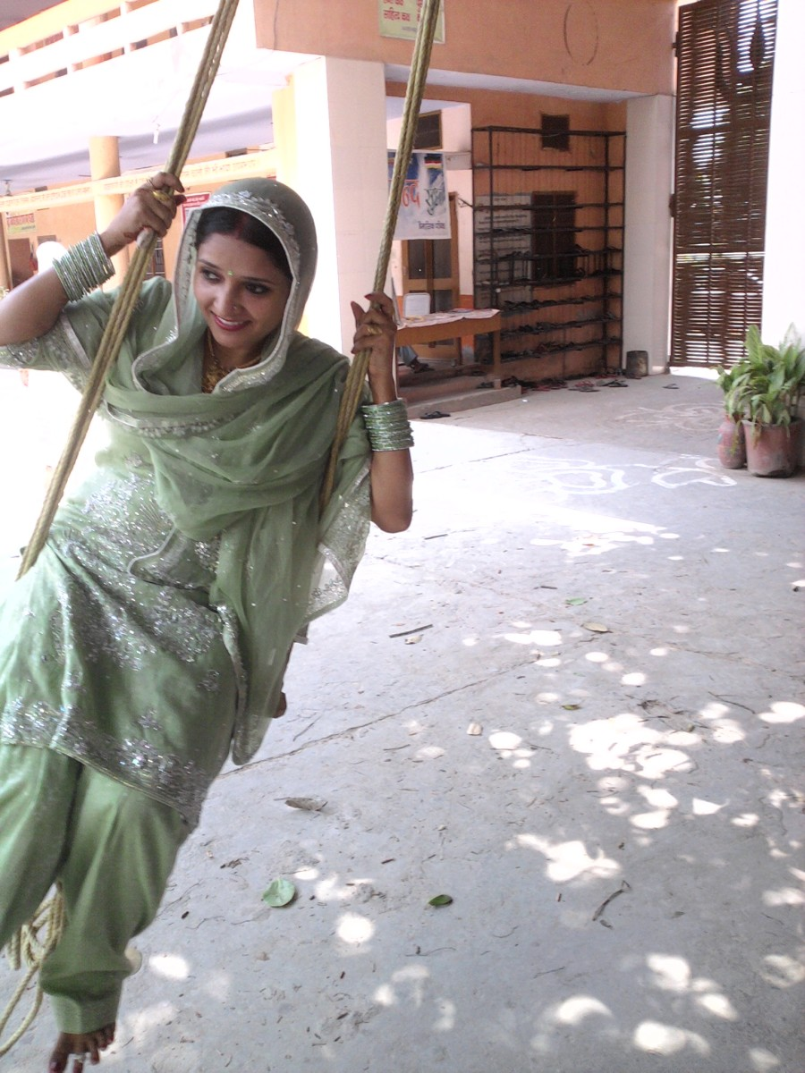 Haryali Teej is a festival when girls play on swings that are set up under trees or open courtyards.