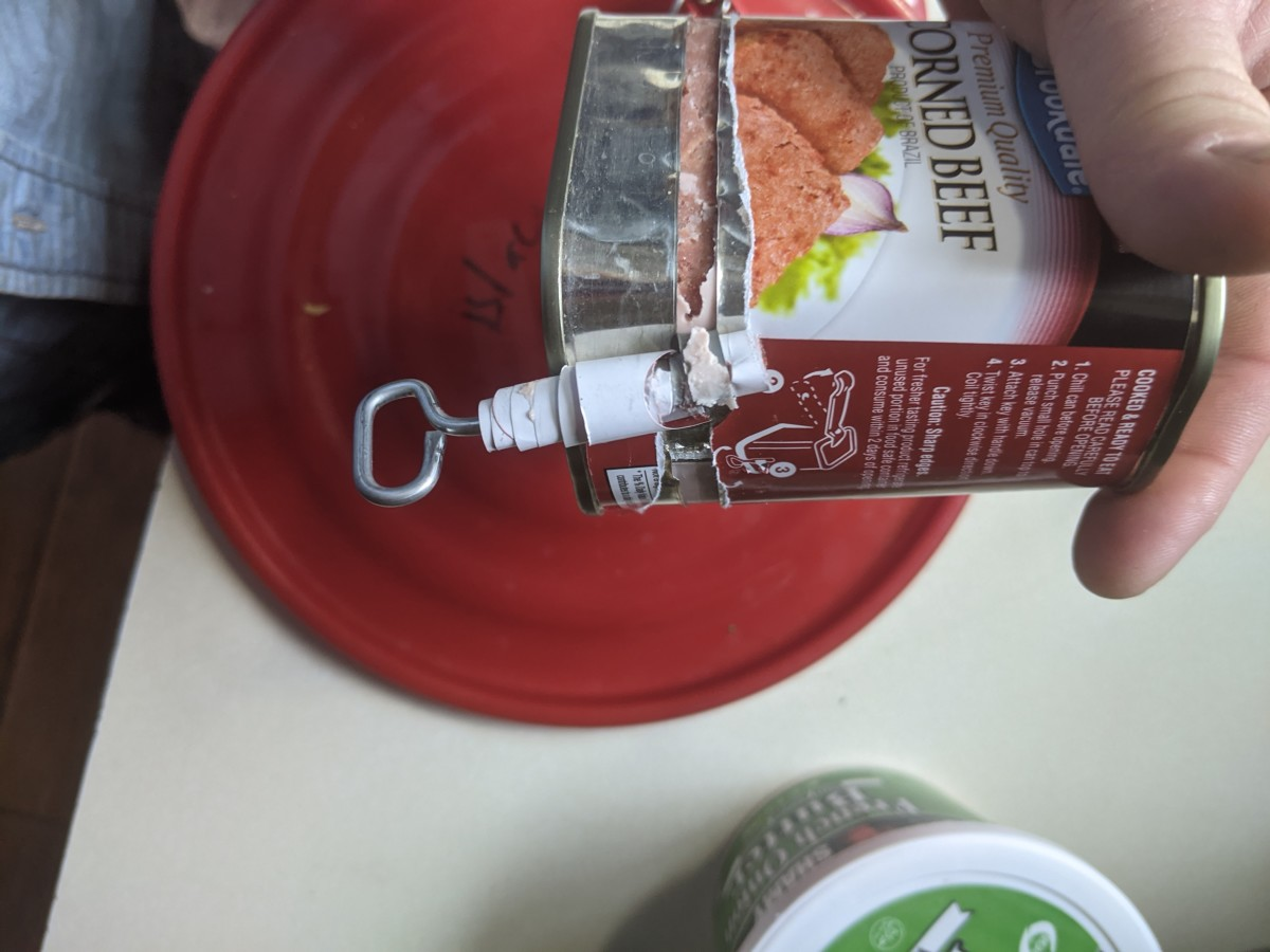 turn key and roll metal from can onto it.