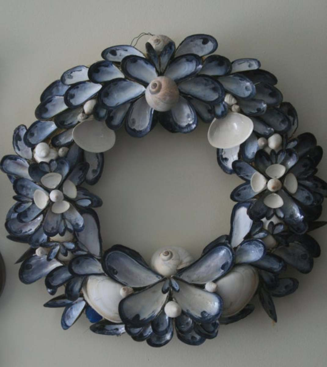 A mussel shell wreath has a lovely blue/black toned color