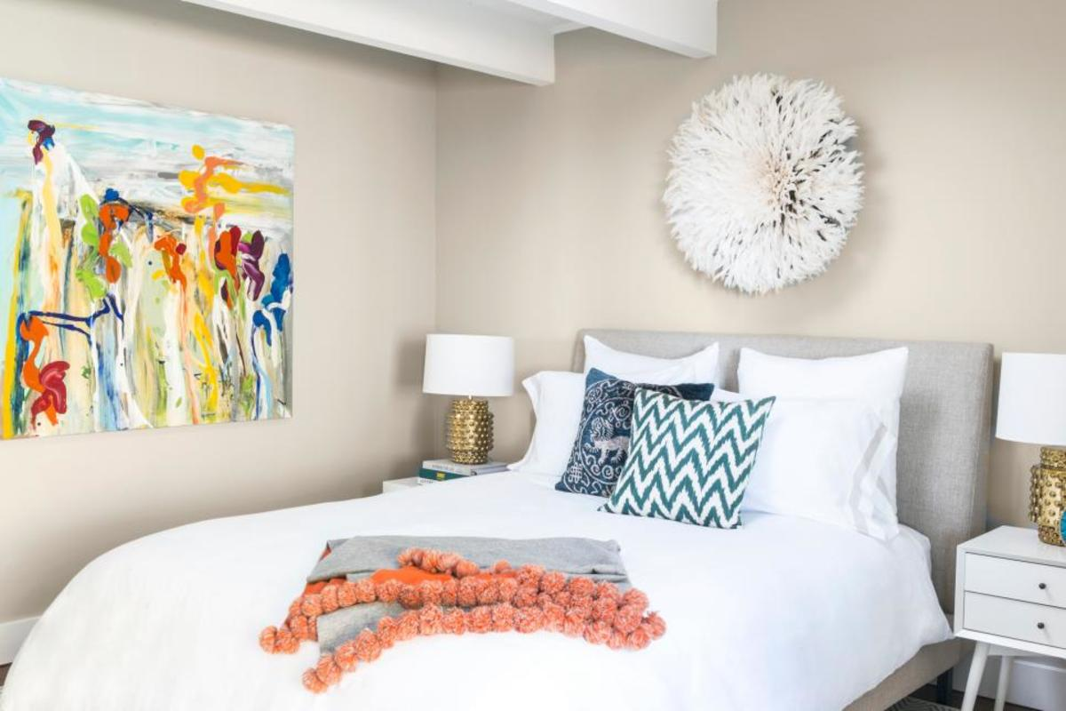 The vibrant wall art on the inviting in the teenager guest room.