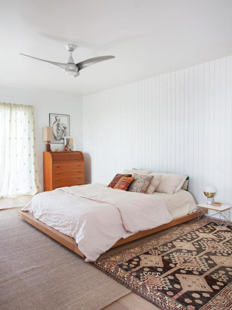 The blonde hardwood floors and a vintage bohemian area rug replaces.
