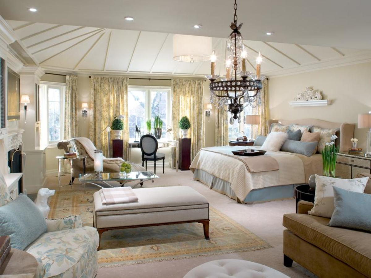 A study area solves the bay windows' identity crisis, and both creamy new carpeting and an elegant area rug create continuity between new sitting areas.