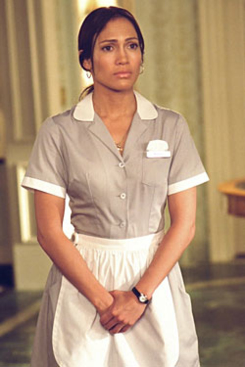 The Most Famous Hotel Maid from the movie Maid in Manhattan - Jennifer Lopez dressed in the housekeeping uniform of the hotel with apron