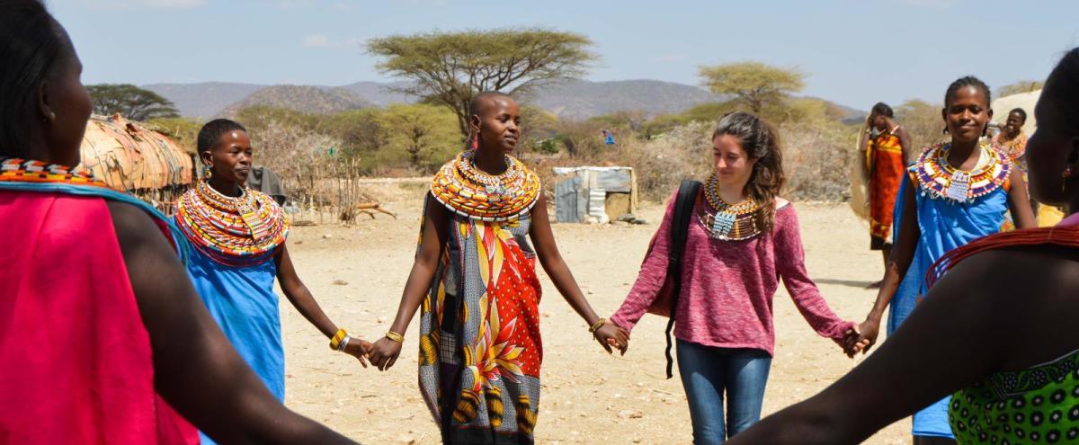 Samburu locals holding hands with tourists  visiting their land