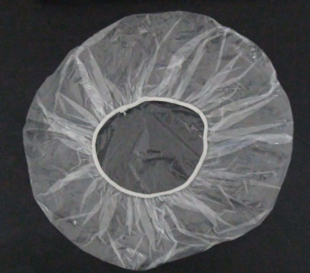 You want the cheap kind of plastic shower cap that you can toss once you are done using it.
