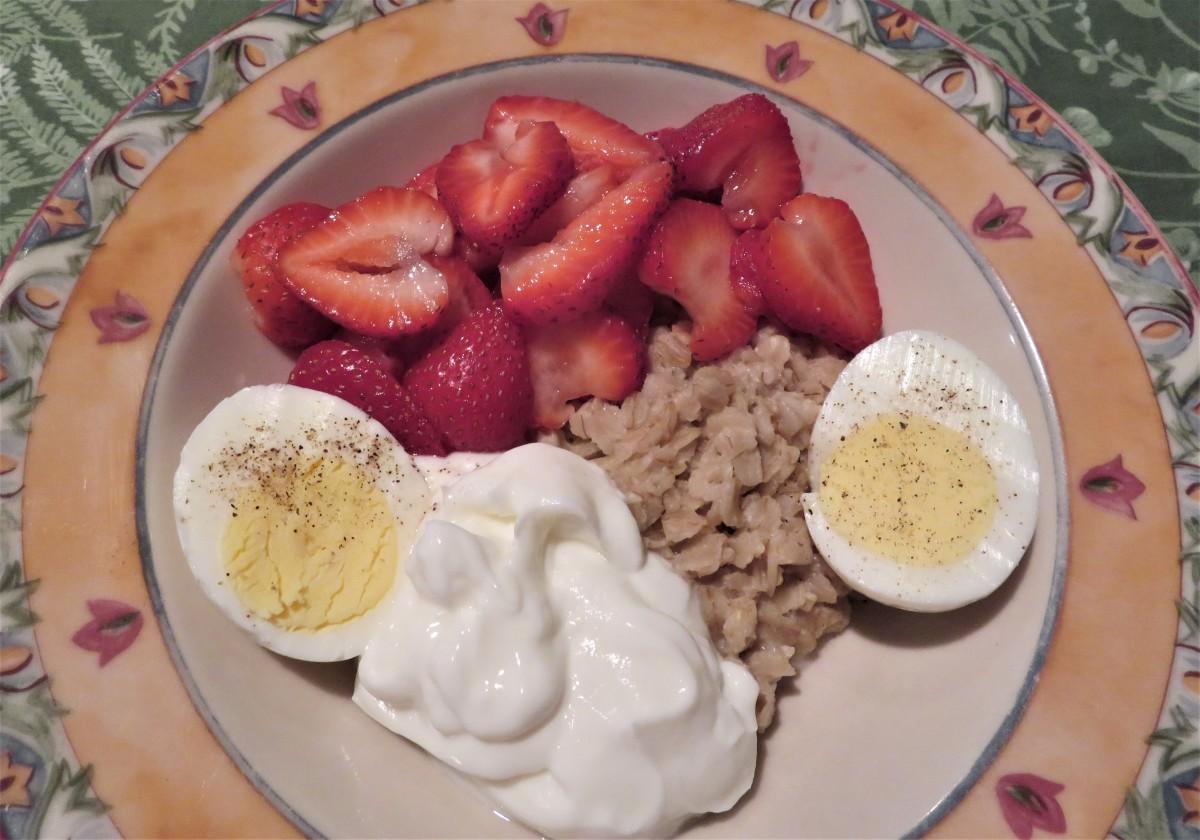 Oatmeal Bowl With Strawberries, Greek Yogurt, and Hard-Boiled Egg