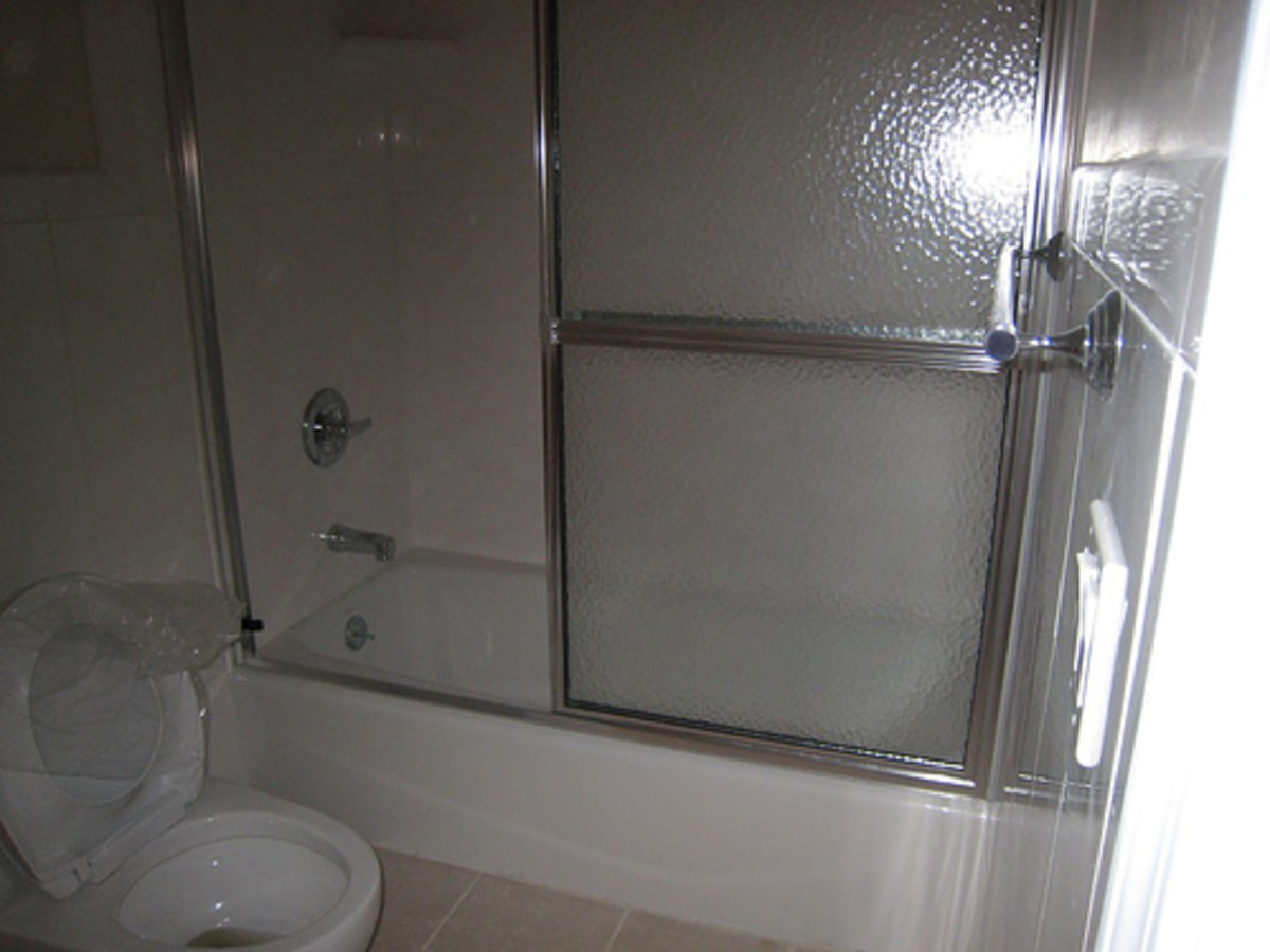 Easy way to make sliding glass shower doors look new again.
