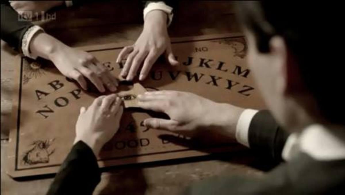 Ouija board seance.
