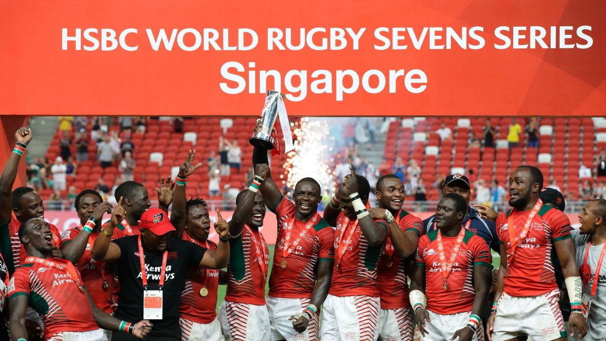 Kenya's captain Adrew Amonde lifts the Singapore series cup