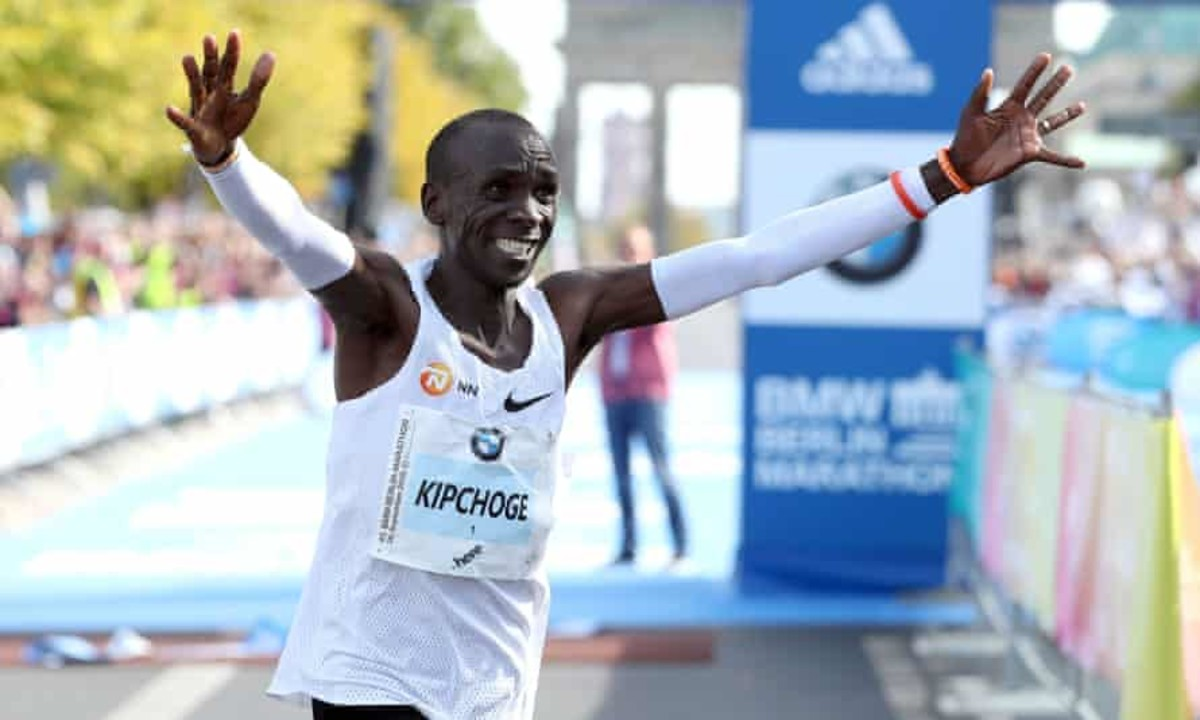 "Kenya's Eliud Kichoge celebrates breaking the ""2 hour"" mark in marathon"