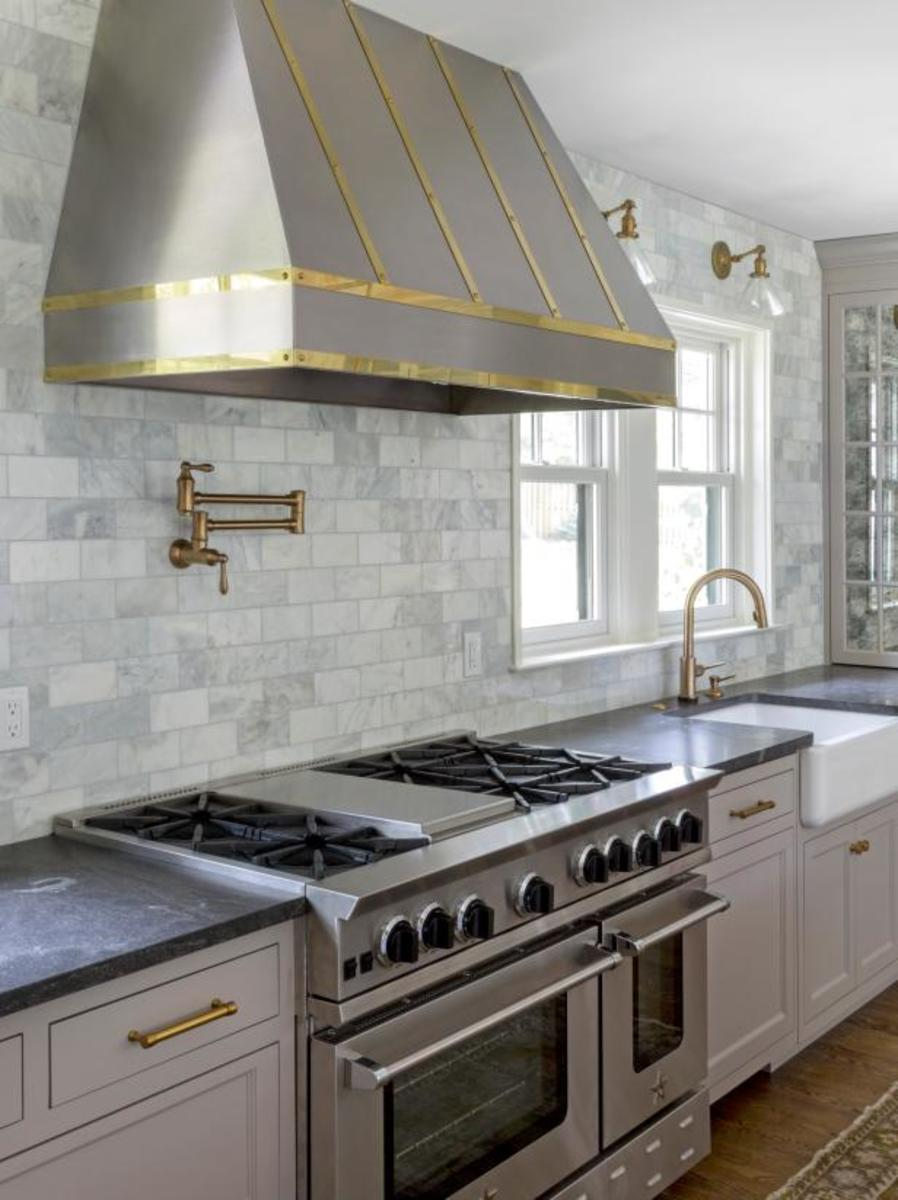 The stainless and the gold and the big range hood.
