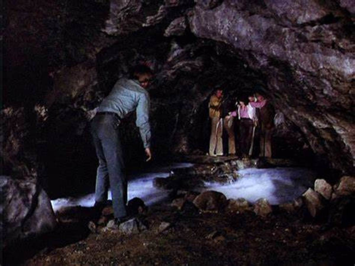 Dennis Cole leads the group of survivors over some heated rocks
