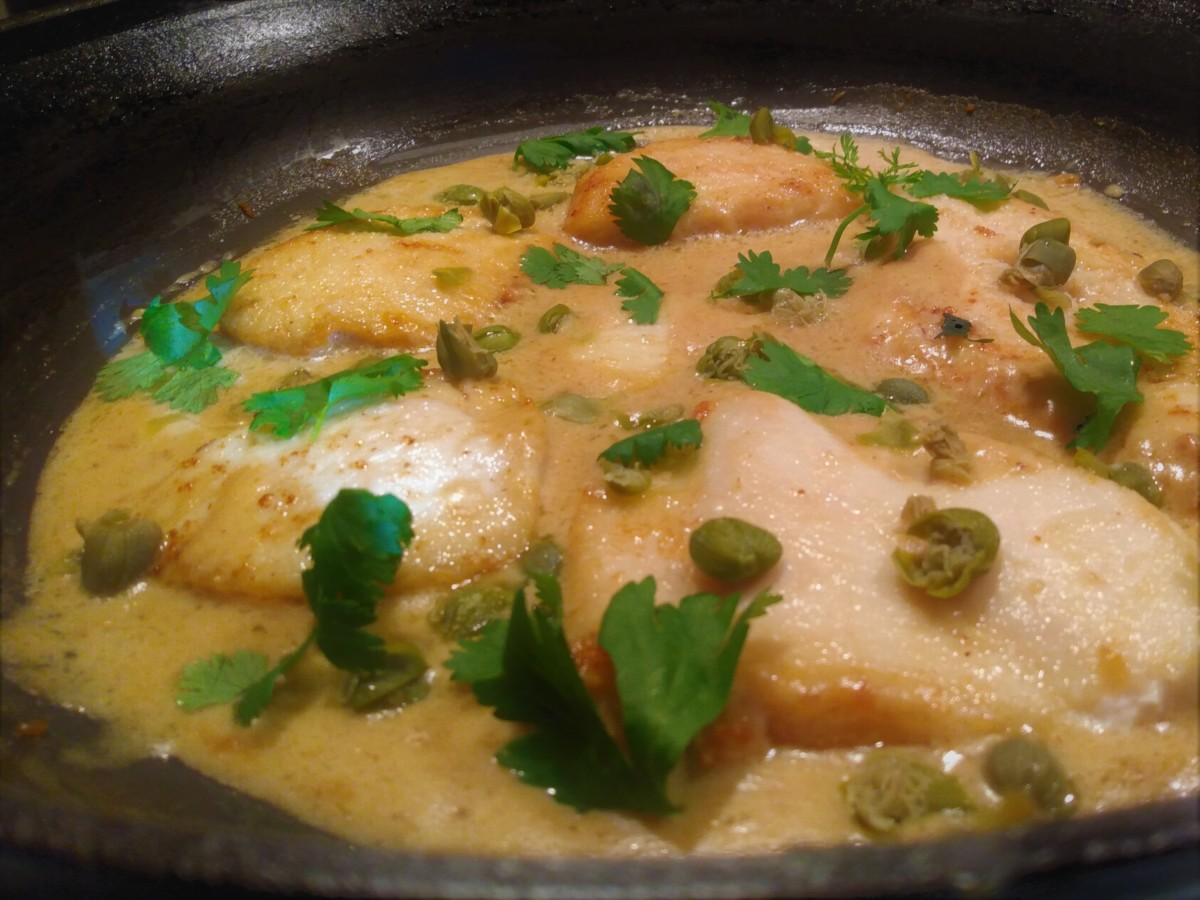 Chicken piccata simmering in the saute pan