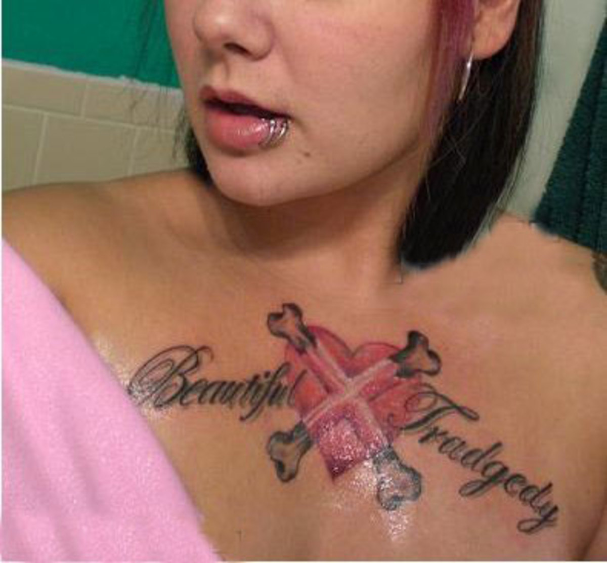 The tragedy is she's probably very beautiful, except for the heart and crossbones on her chest, and the terrible spelling.