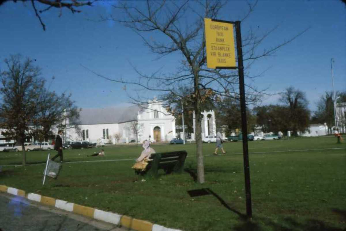 "The central square in Stellenbosch, known as the ""Braak"" with a typical apartheid sign. Photo by Tony McGregor 1968"
