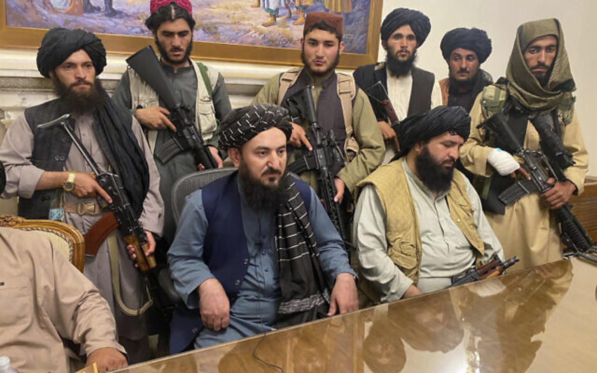 Taliban leader in presidential palace after taking control of the city of Kabul.