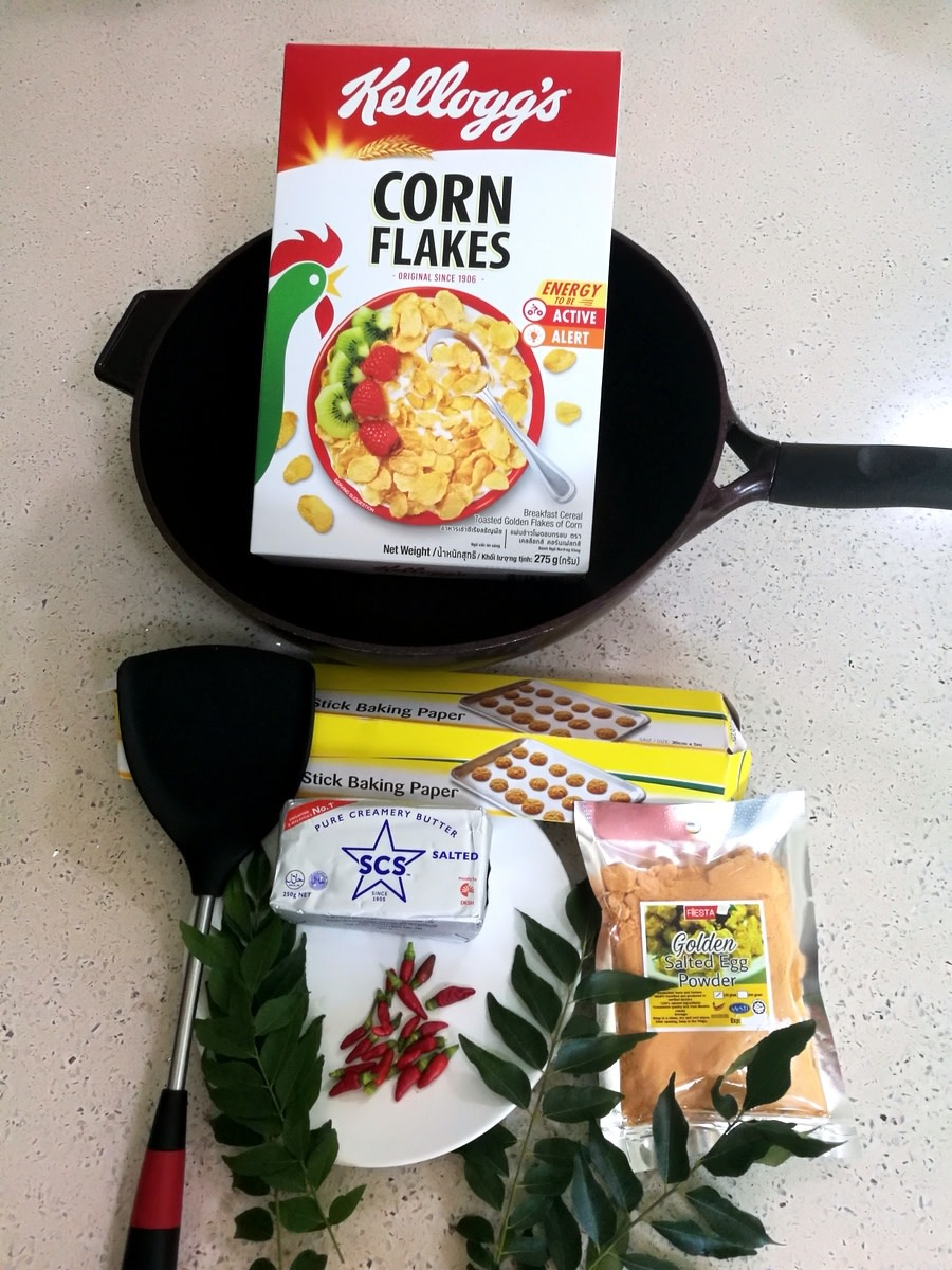 Ingredients and utensils for spicy salted egg cornflakes recipe