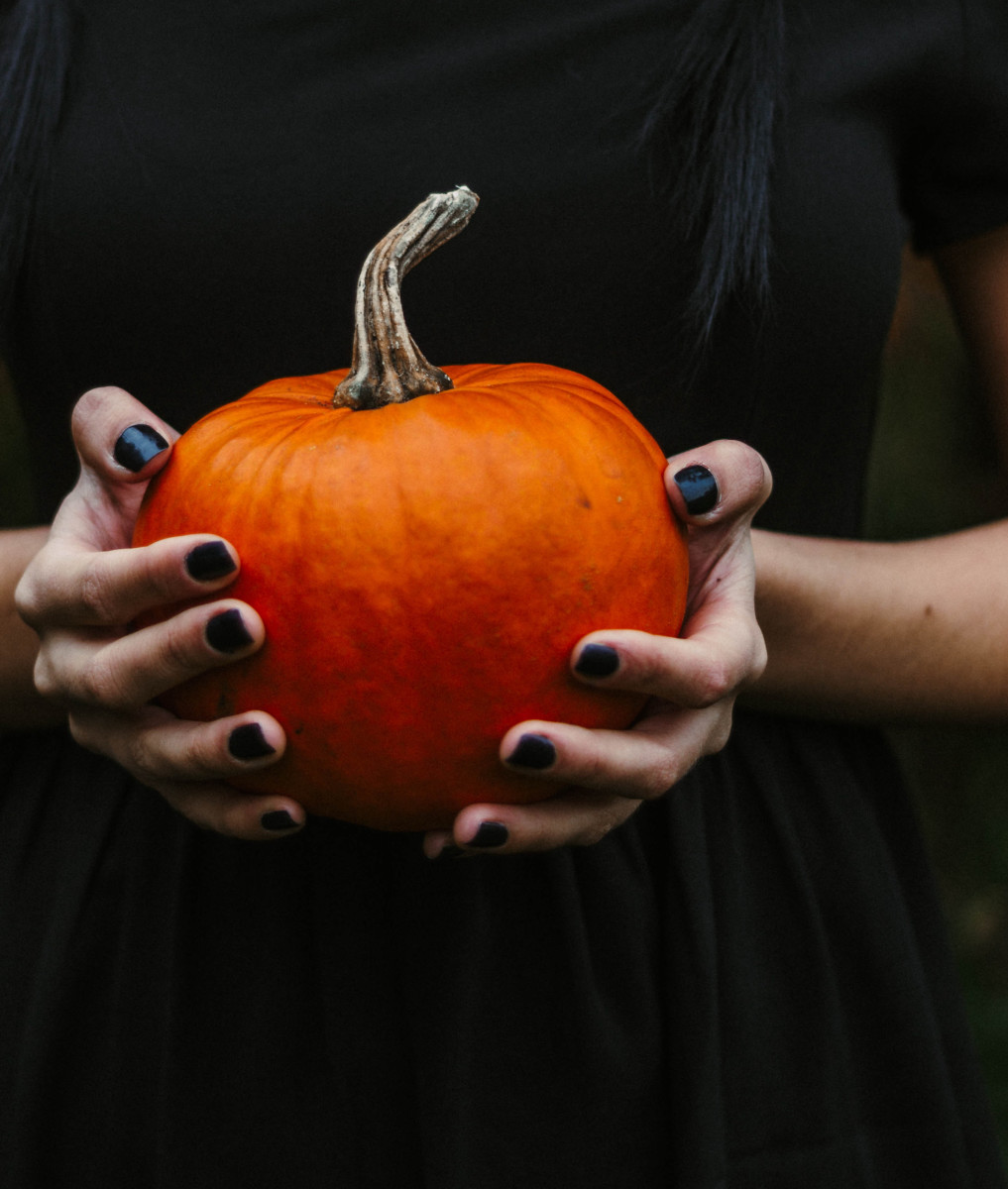 Ask friends to bring a pumpkin, and they can have fun carving it. Photo by Kristina Paukshtite from Pexels