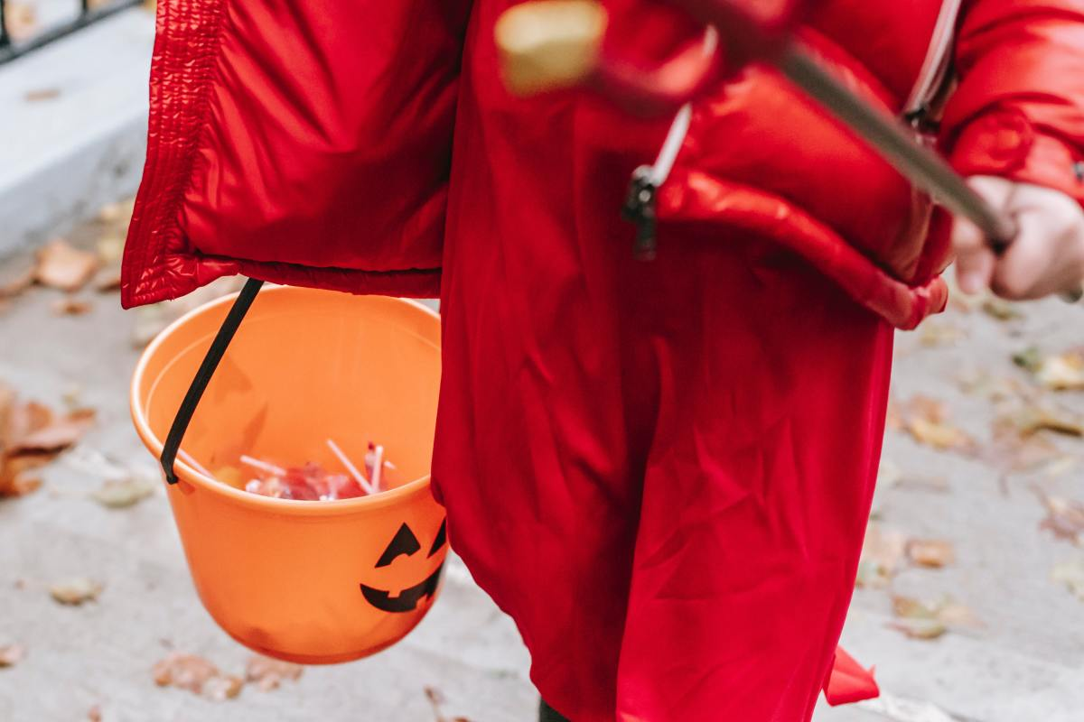 Give out Halloween candy, and watch the younger children's excitement. Photo by Charles Parker from Pexels