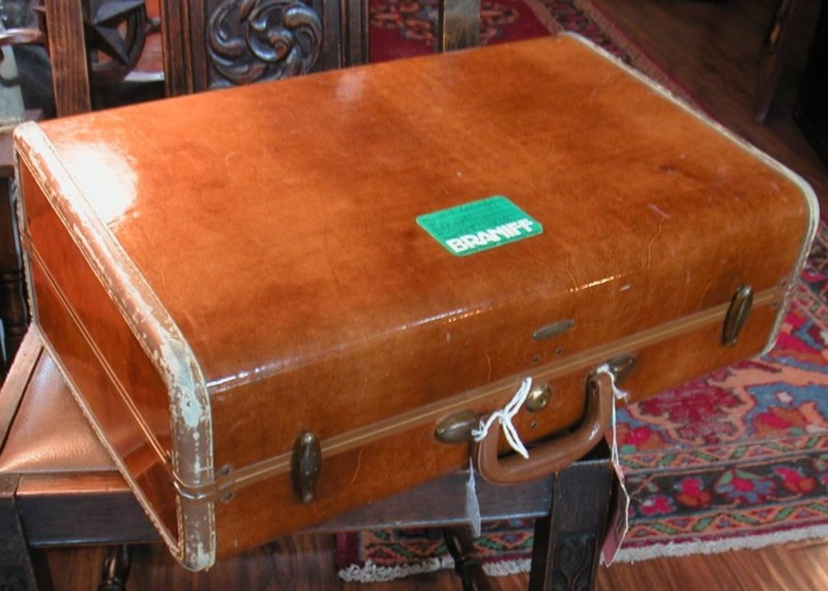 Vintage Suitcase with a Braniff Airlines sticker