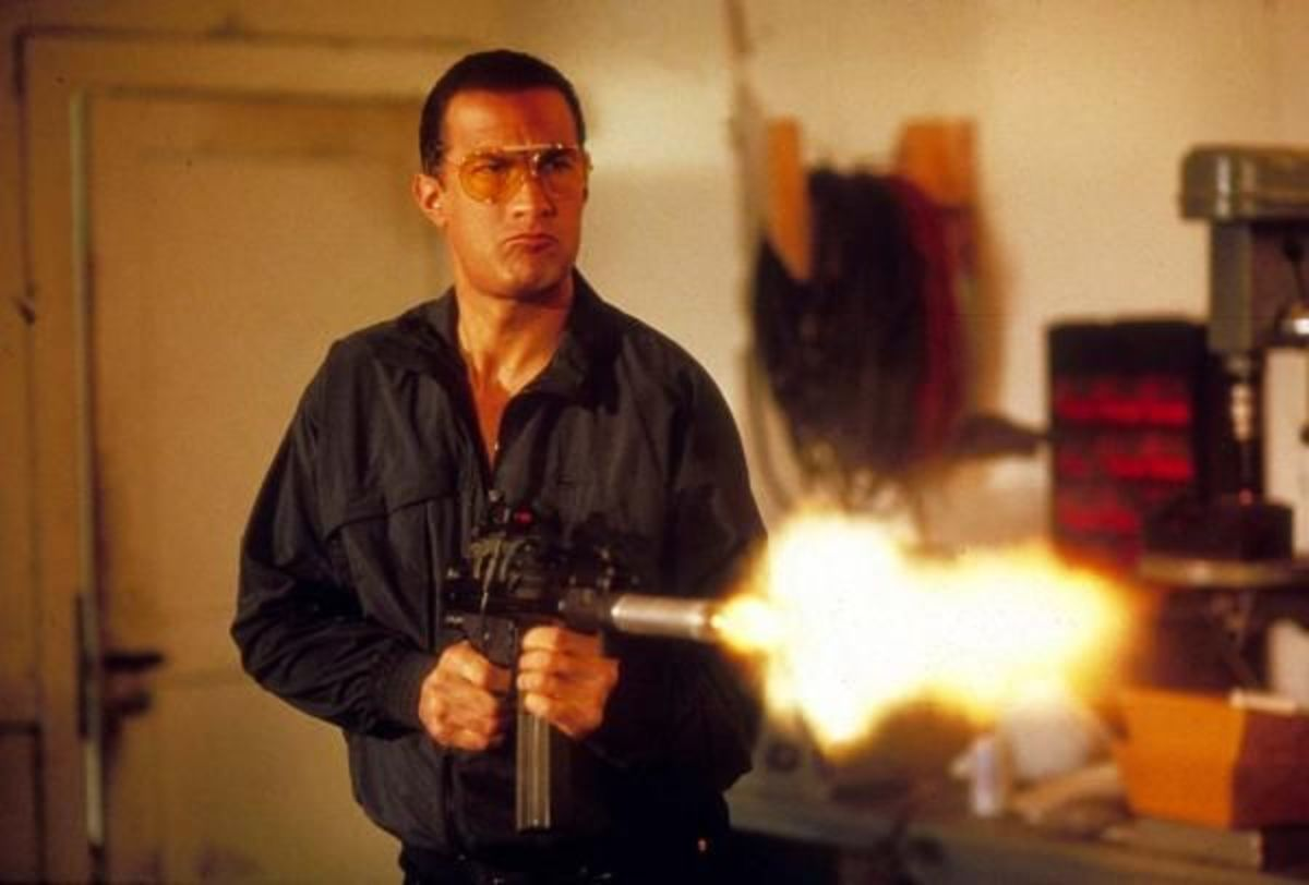 Seagal dishing out some justice, with a machine gun and a silly macho expression
