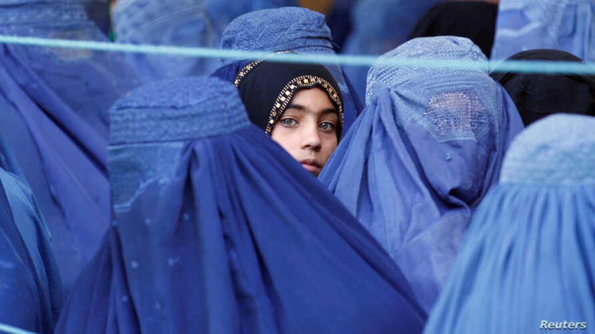 Women in Afghanistan wearing a full body burqa.