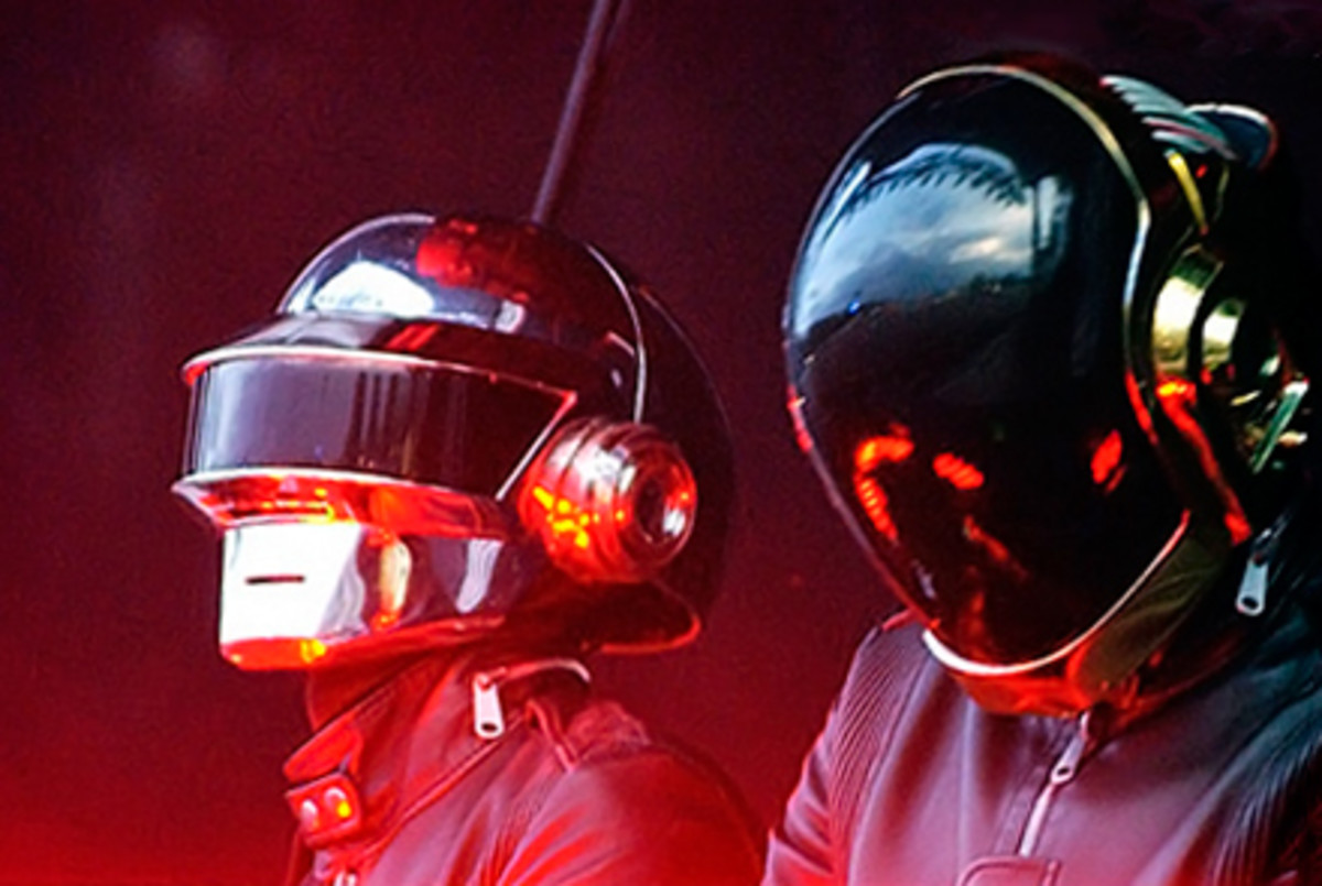 Daft Punk all dressed up and performing on their Alive tour in 2007.