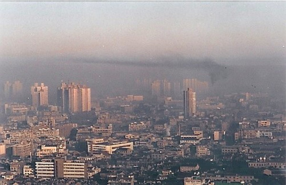 A city covered by smog is a bad environment for people with circulatory problems.