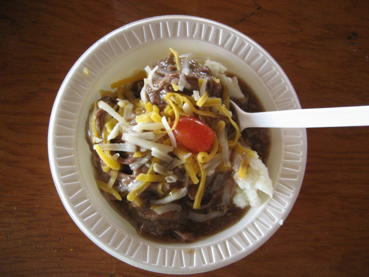 """The """"hot beef sundae"""" at the Cattlemen's Beef Quarters is hot beef and gravy over a scoop of mashed potatoes and a cherry (tomato) on top."""