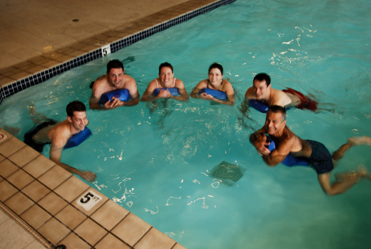 group of young adults with the swim board
